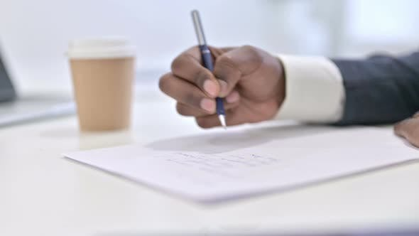 Thumbnail for Hands of African Man Working on Financial Documents