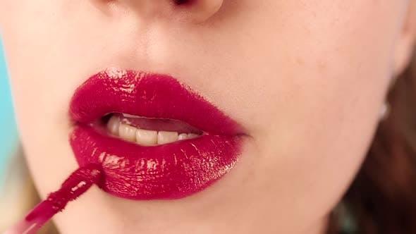 Makeup Master Applies Lipstick