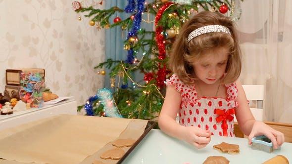 Thumbnail for Little Girl Baking Christmas Cookies
