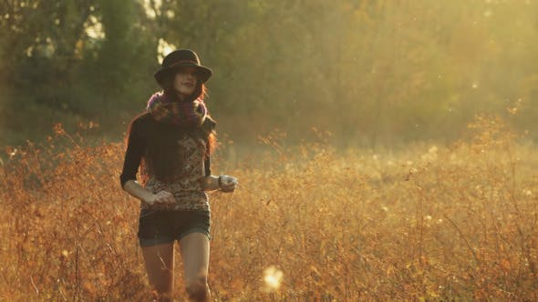 Thumbnail for Girl in the Hat Walks in the Evening on a Meadow