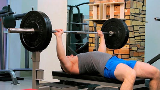 Thumbnail for Man Does Bench Press Barbell 1