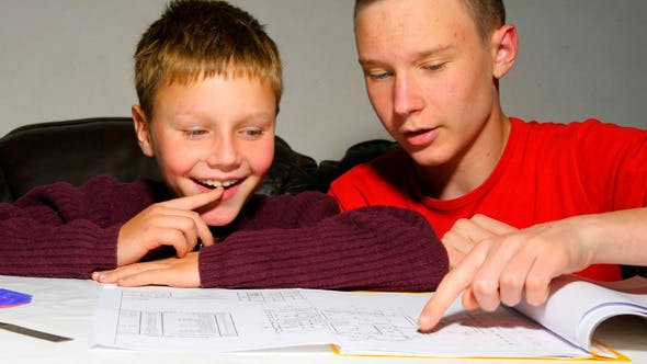 Thumbnail for Teen Explaining Architectural Plan To His Brother