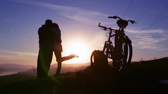 Thumbnail for Couple in Love on a Hilltop Admire the Sunrise 4