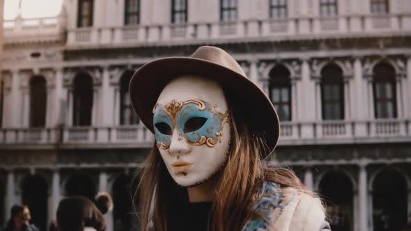 Thumbnail for Close-up Shot of Beautiful Female Tourist Wearing Traditional Carnival Mask at Venice San Marco