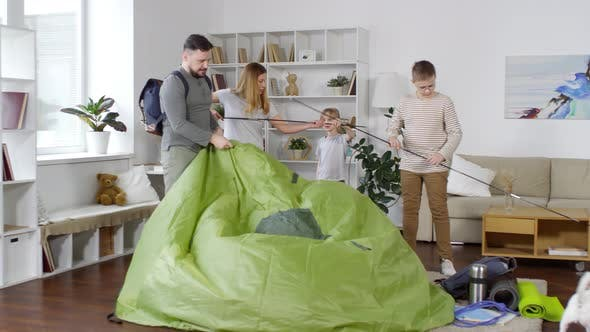 Thumbnail for Family Putting up Tent Together