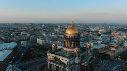 Russian cult art Isaak cathedral zoom in gold dome over city