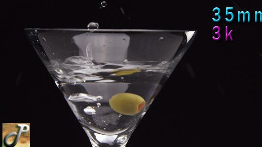 Thumbnail for Martini Cocktail With Olive Falling In The Glass