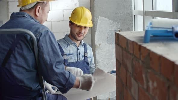 Thumbnail for Workmen Discussing Blueprint