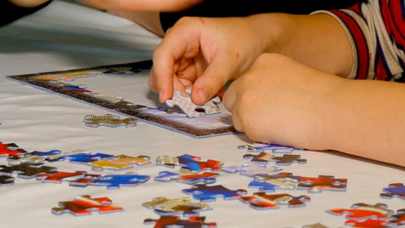 Thumbnail for Child Hands Assemble Jigsaw Puzzle