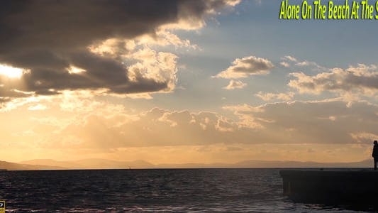 Thumbnail for Alone On The Beach At The Sunset