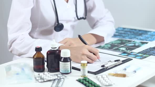 Doctor Prescribes A Prescription For Antibiotics To The Patient