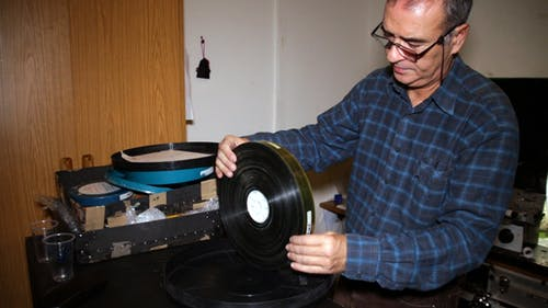 Film Technician Checking the Status of the Film