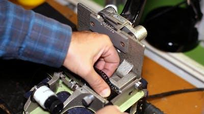 Film Technician Cutting 35mm Film