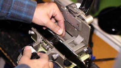 Film Technician Splicing 35mm Film