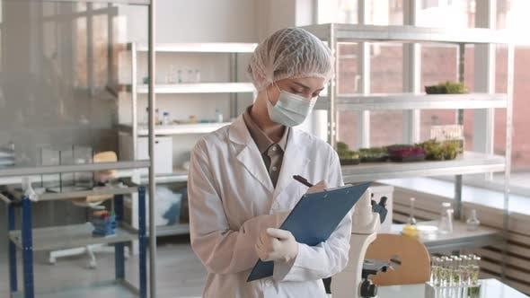 Thumbnail for Portrait of Female Biologist Doing Paperwork