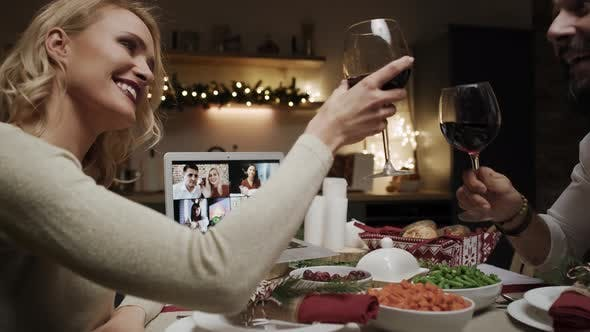 Thumbnail for Tracking video of couple having video conference during Christmas dinner