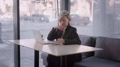 Businesswoman in a Cafe