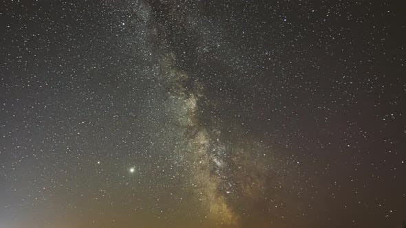 Night Starry Sky With Glowing Stars. Bright Glow Of Planets Saturn and Jupiter In Sky Among The