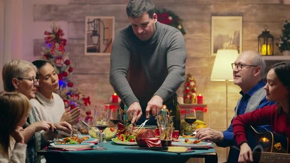 Thumbnail for Adult Man Slicing the Chicken for Christmas Celebration