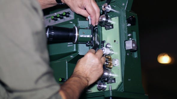 Cover Image for Film Technician Mounting 16mm Film Projector
