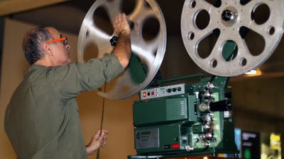 Film Technician Mounting 16mm Film