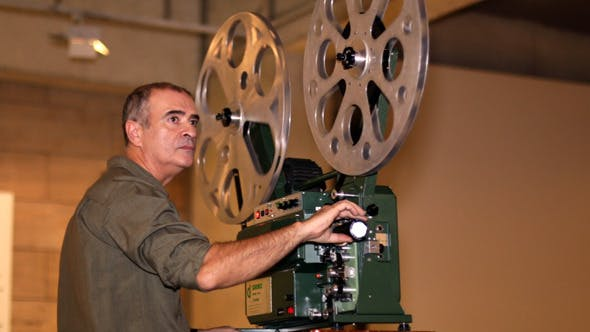 Cover Image for Film Technician Projecting 16mm Film