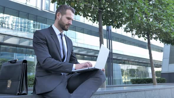 Thumbnail for Beard Businessman working on Laptop Outside Office