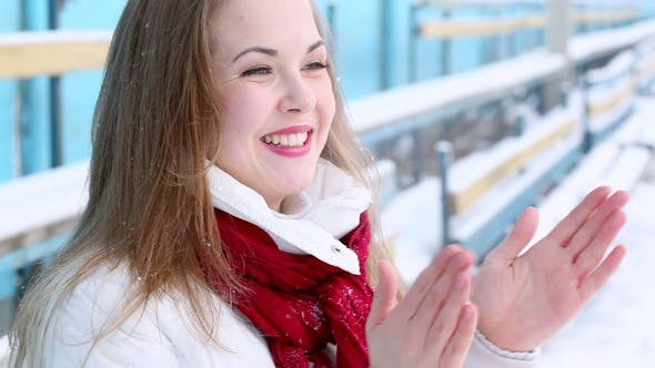 Thumbnail for Young Woman Cheering at an Empty Stadium in Winter