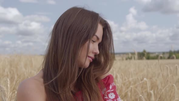 Thumbnail for Portrait Sweet Charming Young Woman Enjoying Nature and Sunlight in Wheat Field at Incredible