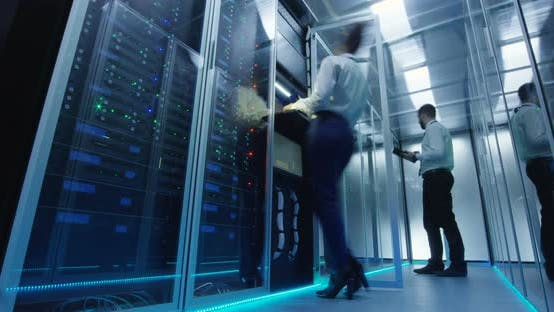 IT Workers in Glowing Data Center