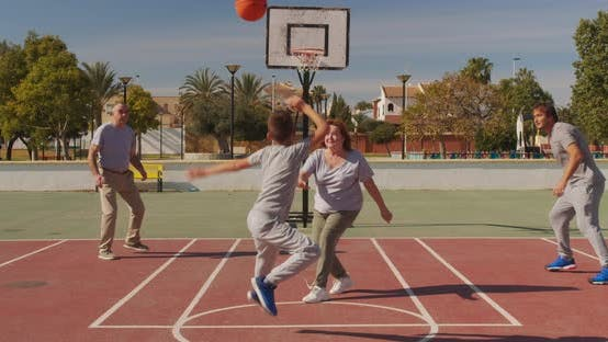 Thumbnail for Multigeneration Family Playing Basketball on Outdoor Court.