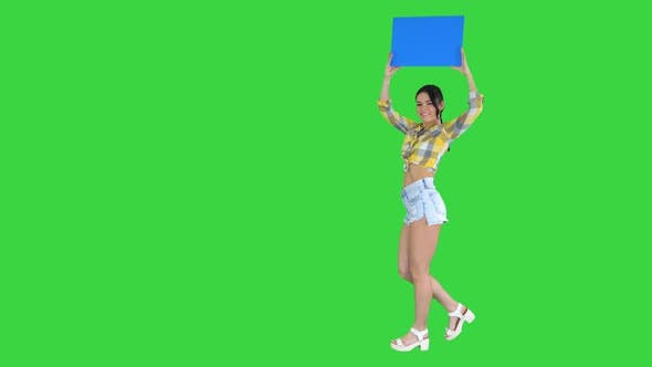 Girl with an Empty Board Announcing New Round on a Green Screen, Chroma Key.