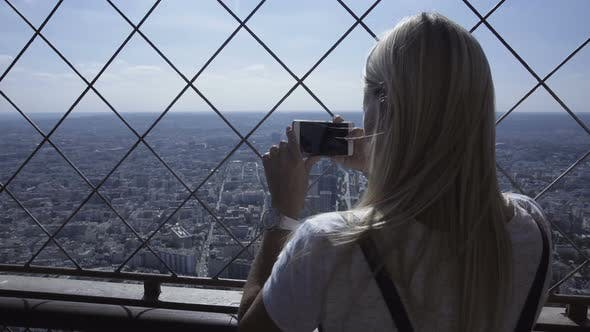 Thumbnail for Woman Taking Photo of Cityscape with Smartphone