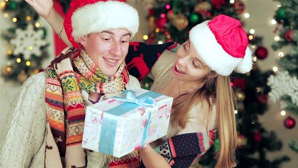 Thumbnail for Loving Couple Hold Christmas Presents