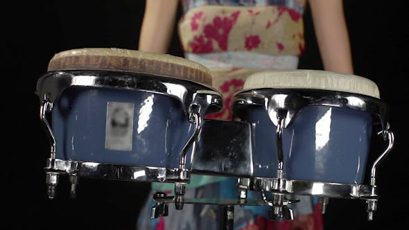 Thumbnail for A Female Percussion Drummer Performing With Bongos