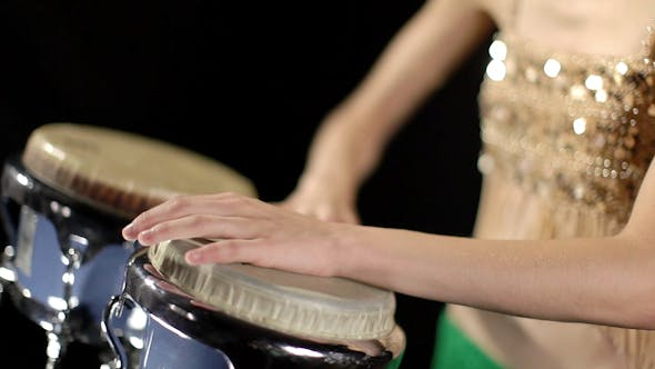 Thumbnail for Beautiful Female Percussion Drummer Performing With Bongos