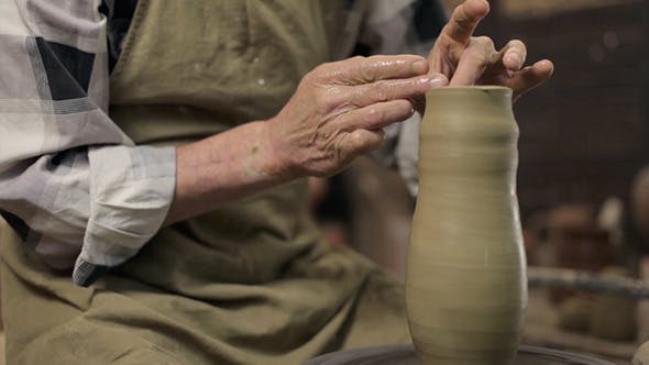 Thumbnail for An Old Master Manufactoring A Vase From Clay