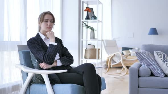 Thumbnail for Pensive Woman Thinking while Sitting on Sofa