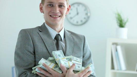 Thumbnail for Businessman Holding Dollar Bills