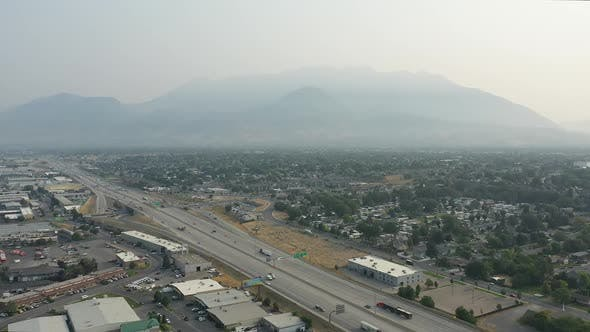 Thumbnail for Aerial view of traffic on I-15 in Utah County with smokey skies