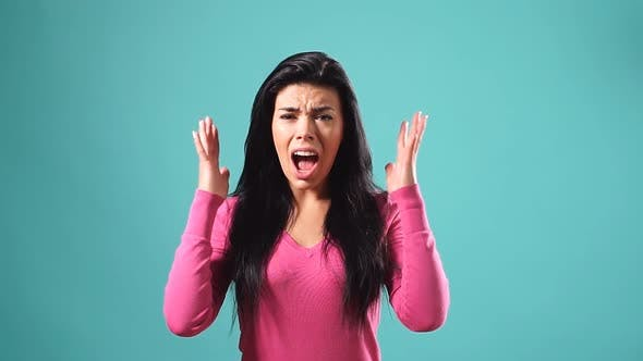 Portrait of Pleasant Brunette Girl Throwing Up Her Hands