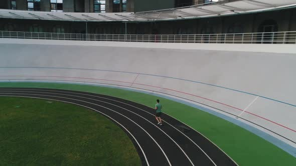 Thumbnail for Guy Runs in the Stadium Aerial View