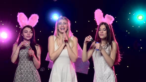 Cover Image for Happy Girls at Bachelorette Party Blowing Soap Bubbles. Slow Motion