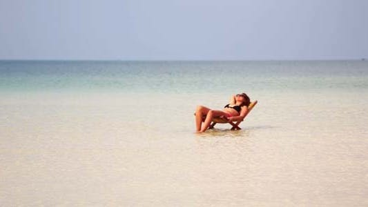 Thumbnail for Woman Sunbathing In Gorgeous Water, Cambodia