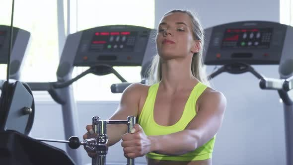Thumbnail for Beautiful Sportswoman Doing Seated Cable Rowing Exercise at the Gym