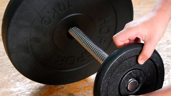 Thumbnail for Adding Weights To A Dumbbell