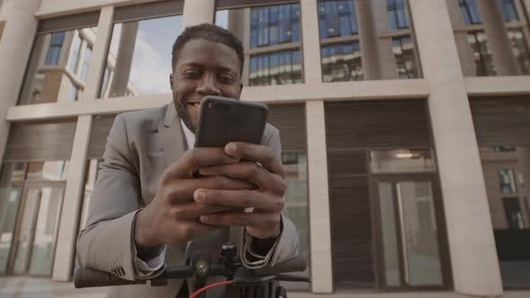 Thumbnail for Businessman Messaging with Friends in Downtown