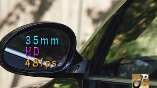 Adjusting The Mirror On A Sports Car