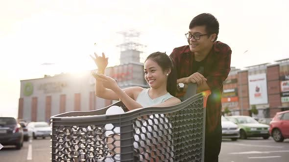 Adorable Asian Pair of Young People Spending their Time with Joy