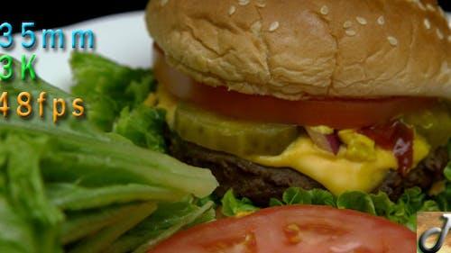Juicy Cheeseburger And Salad Meal